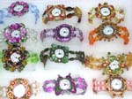 Import glamour watch agent sells fashion jewelry to retail store. Fashion enamel frame in star, butterfly and flower design holds watch clock. Band created from colored beads