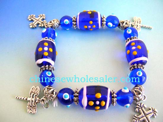 Beaded lampwork China jewelry distribution wholesalers supplying Fashion stretchy blue bracelet with multi white green hand-painted Chinese lampwork glass bead and silver beads handing a cross charm design