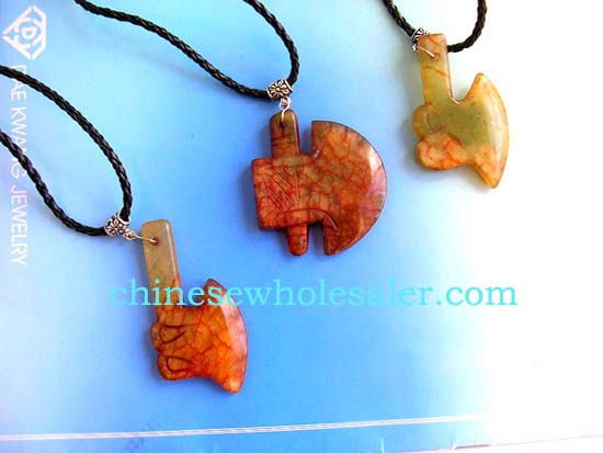 China exported crafted jade jewelry sold wholesale. Twisted black cord necklace with genuine chinese brown / yellow jade hammer or tomahawk pendant