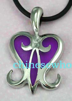 Fashion costume jewelry supplies retail stores.  Black cord fashion necklace with purple colored heart designed pendant.