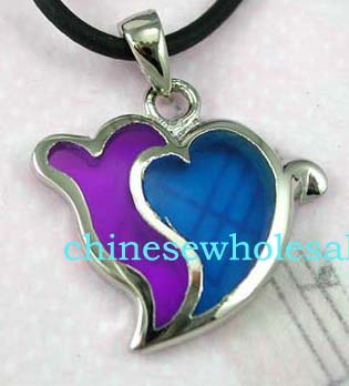 Trendy jewelry necklace supplied online wholesale. Black cord fashion necklace with purple and blue double hearted pendant.