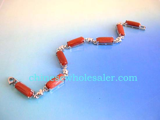 Silver jewelry wholesale supply store sells gemstone bracelets. Gold sand stone fashion bracelet in long shape connected with silver heart design and chain lock for closure    .