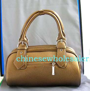Purse/ handbag wholesale manufacturers exporting fashion accessories from China. Imitation leather shiny brown hand bag with double zipper and belt knot-like design on handle, also zipper top, zipper pocket on back and inside zipper pocket