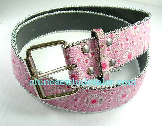 China clothing wholesale export agency. Pink cloth belt with floral design and silver bead outline, Large square silver buckle for fashionable look.