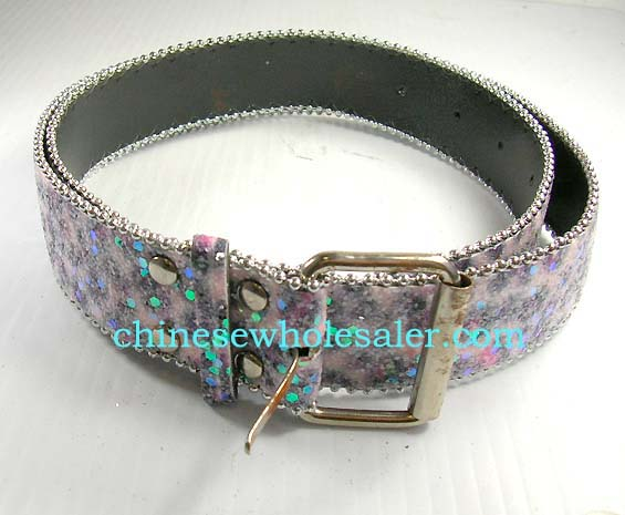 Fun, flirty belts supplied wholesale from China distributor. Lady belt with glittery green and blue dots on top of purple and pink base. Siver beads outline belt and make up buckle.