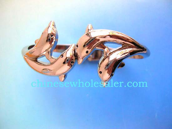 Wholesale dolphin and silver jewelry supplied by international distributors with products made in China. Silver plated bracelet with four dolphins, two dolphins on each side facing each other to form curved bracelet, spring at back to open and close.