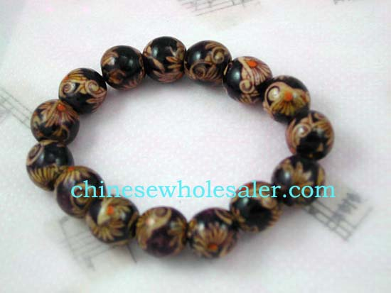 Fashion China wholesale gifts distributed by global importer. Dark Brown wooden beaded bracelet designed with yellow and dark orange sun and flower pattern