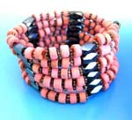 Hematite jewelry worn for therapeutic aids supplied online by China wholesale dealer. Pink wooden beads, flower shaped ilver beads and multi faceted cylinder hematite beads. Wear as necklace, bracelet, or arm band.