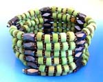 Magnetic health products supplied wholesale by China importer. Green wooden beads, flower shaped silver beads and multi faceted cylinder hematite beads. Wear as necklace, bracelet, or arm band