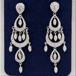 Cubic Zirconia wholesale jewelry export company supplies womens fashions. Gypsy styled earings with three levels of rhodium plated ovals and cz stones hanging within