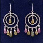 Wholesale jewelry direct store distributes cz fashions. Gyspy styled earings with cut out circle within another and yellow cz stone at center. Green, pink, and yellow cz stones hang beneath larger circle.