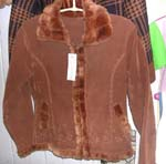 Dark brown color lady's imitation leather long coat; faux fur lined along at bottom;neck and zipper part; two pocket; zipper-up front closure