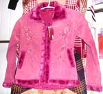 Pink color lady's imitation leather long coat; faux fur lined along at bottom;neck and zipper part; two pocket; zipper-up front closure