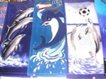 Assorted dolphin towel with playing sport design