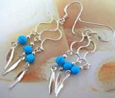 Solid 925. sterling silver French hook style earring with triple S shape holding a turquoise beads and dangle