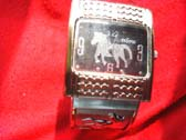 Black bangle bracelet watch with a variety of sized cz gems on strap